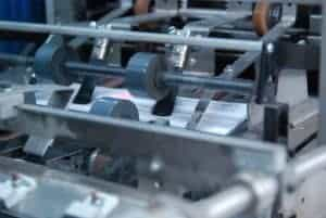 A close-up look of mail going through Skymail International's inserter machine