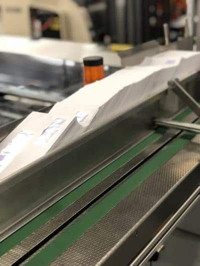 Image of Skymail's inserting machine cycling envelopes