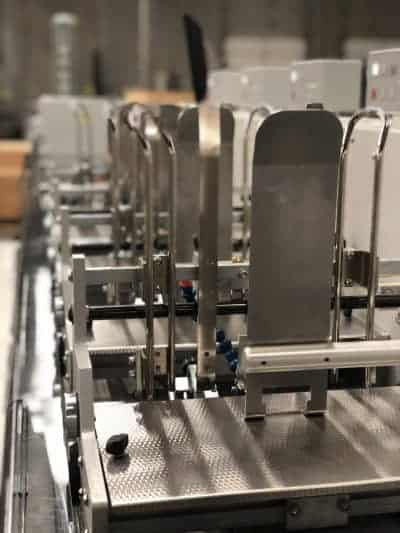 Close-up image of the machinery of Skymail's mail inserter